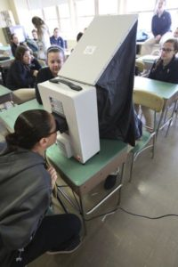 Students using facial scanners.